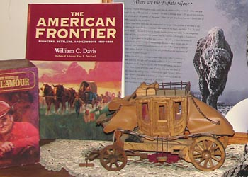Details from Rosanne's office -- stagecoach model and some of her reference books